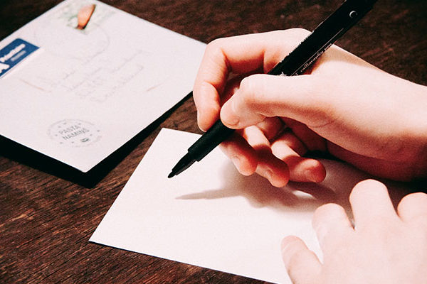 Starting a Design Blog: Hand writing on a notepad